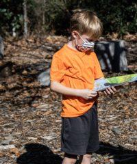 Boy Viewing Mystery of Blackbird Pond Book