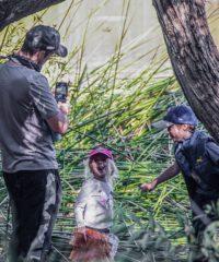 Family Exploring Pond